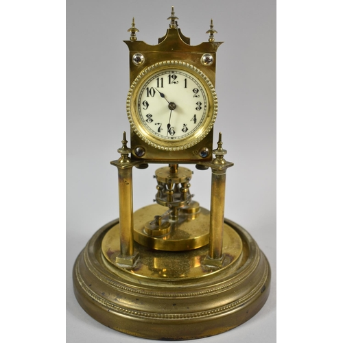 12 - An Early 20th Century Angemeldet Patent Brass Torsion Clock with Glass Dome and Circular Base, 26.5c...