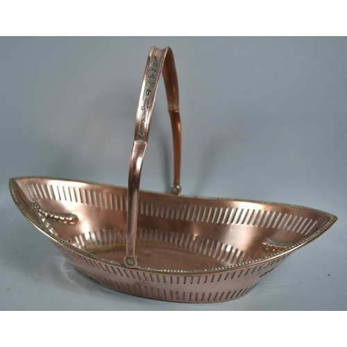 44 - A Former Sheffield Plated Boat Shaped Basket with Pierced side and Swag Decoration, 32.5cm wide...