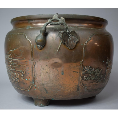58 - A Japanese Bronze Two Handled Jardiniere Decorated in Relief with Family Beside River, On Three Feet...