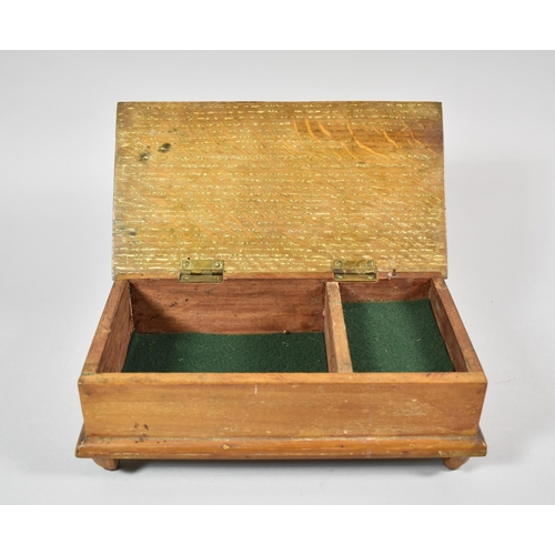 16 - An Edwardian Lift Top Oak Musical Jewellery Box of Sarcophagus Form, 25cm wide (working order)...