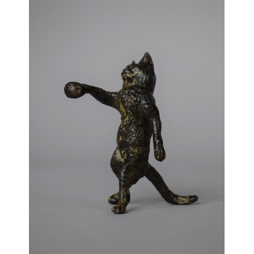 23 - An Austrian Bronze Anthropomorphic Study of Standing Cat with Paw Outstretched, 7cm high...