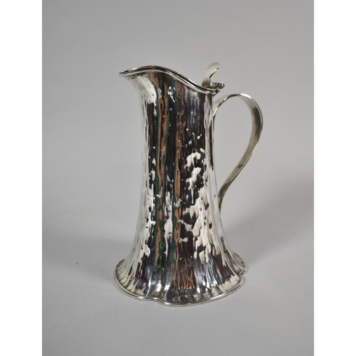 3 - A Hukin & Heath Arts and Crafts Silver Plated Lidded Hot Water Jug, no.16296, 18cm high...