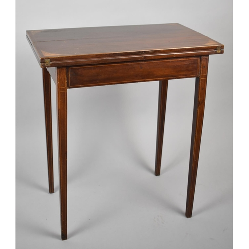 32 - An Edwardian String Inlaid Mahogany Rectangular Games Table with Hinged Envelope Top and Beize Playi...