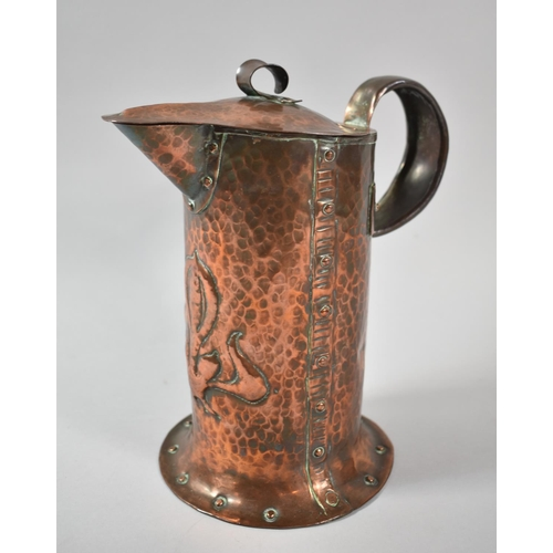 13 - An Arts and Crafts Copper Jug by William Soutter & Sons, 22cm high...