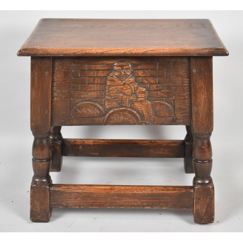 25 - A Mid 20th Century Oak Lift Top Sewing Box with Carved Front and Back Panels, 46cm Wide...