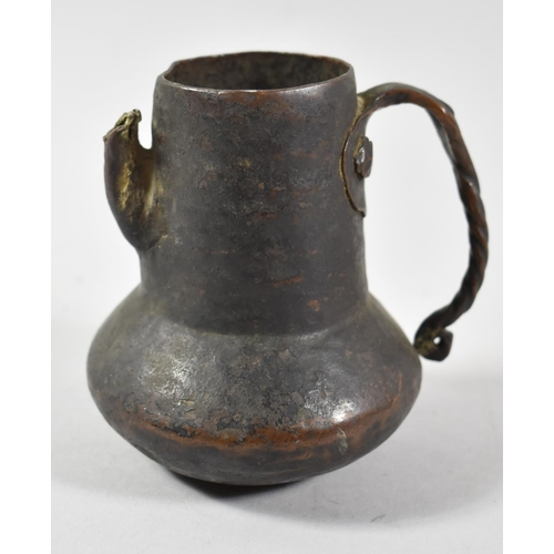 36 - A Hand Beaten Copper Jug with Twisted Handle, Spout AF, 10cm high...