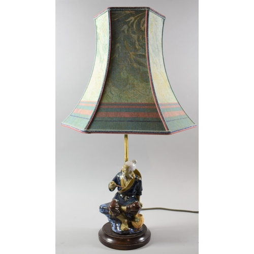 41 - A Modern Oriental Chinese Mudman Table Lamp with Shade, Total Height 60cm...