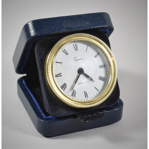7 - A Cased Silver Tregawne Circular Travelling Alarm Clock, Hallmark for London 1986, Working Order...