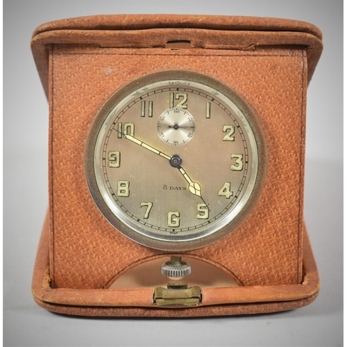 9 - A Vintage Leather Cased Travel Alarm Clock with Working Eight Day Movement...