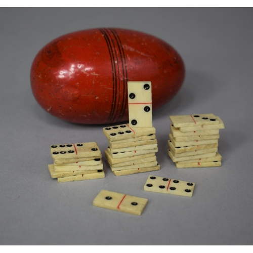 A Collection of 28 Miniature Bone Dominoes, Possibly Prisoner of War, Housed in Ovoid Container