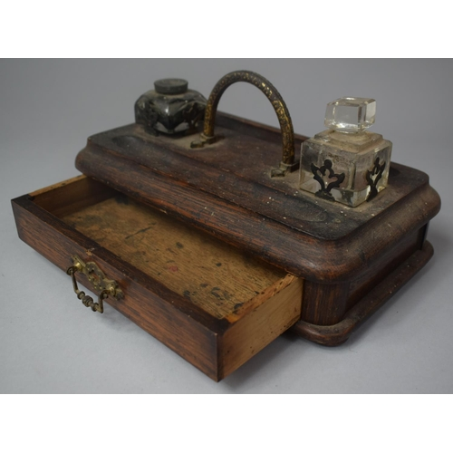 16 - A Late Victorian Desktop Penrest and Inkstand with Two Ink Bottles and Base Drawer, 25cm Wide...