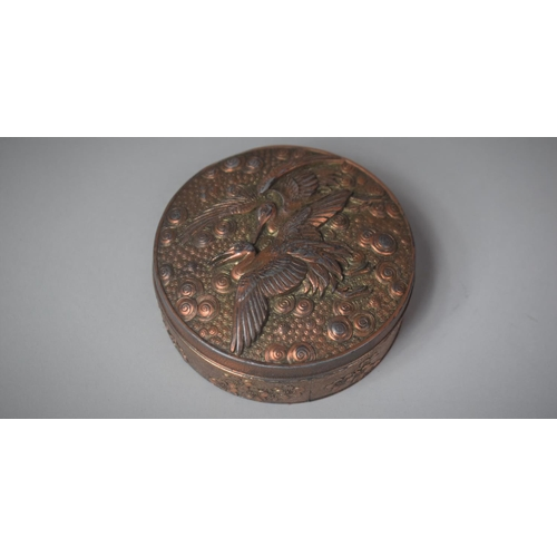 33 - A Modern Copper Patinated Circular Oriental Box, the Lid Decorated with Cranes in Relief, 8.5cm Diam...
