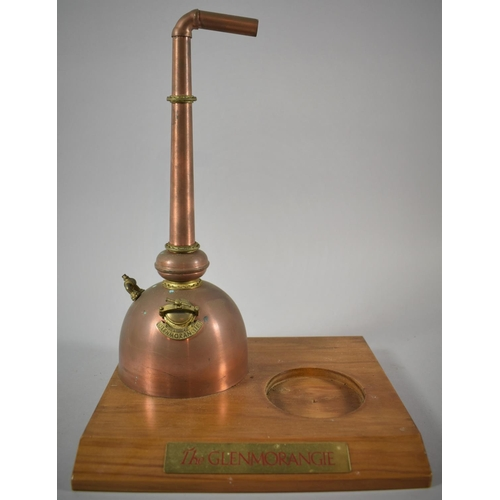 50 - A Modern Glenmorangie Novelty Bottle Stand in the Form of a Copper Still on Wooden Plinth, 31cm high...