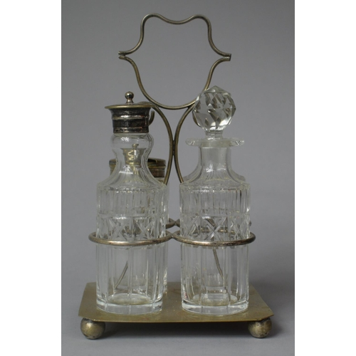 54 - Two Edwardian Four Bottle Cruet Sets with Silver Plate Stands...