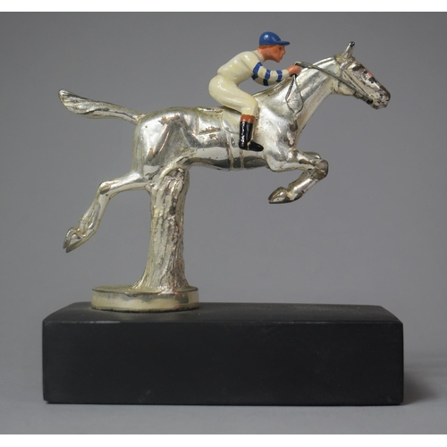 7 - A Chromed Car Mascot in the Form of Racehorse and Jockey Taking Fence, 12.5cm high...