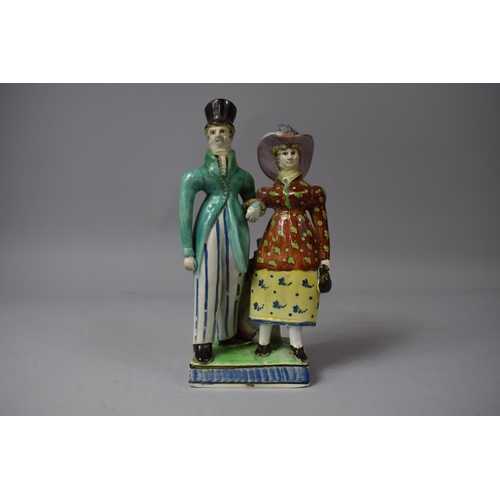 246 - An Early 19th Century Staffordshire Figure Group, 'The Dandies', Gent with Green Coat and Striped Tr...