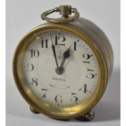 15 - A Small French Circular Drum Alarm Clock, the Silvered Dial Inscribed