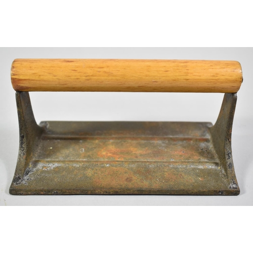 32 - A Cast Metal Bacon Press with Turned Wooden Handle, 17cm Long...