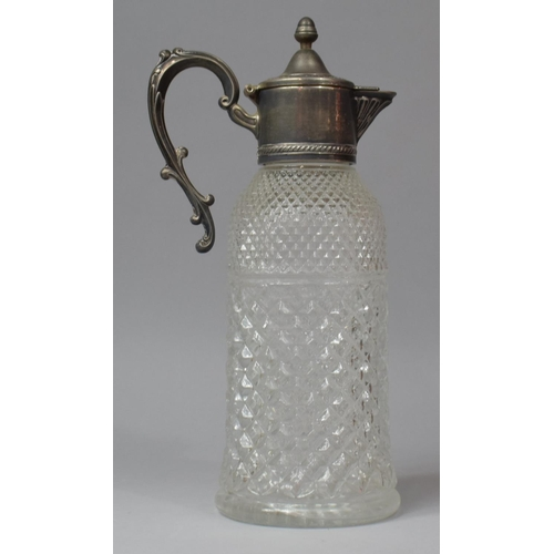 39 - A Moulded Glass Claret Jug with Silver Plated Handle, 32cm high...