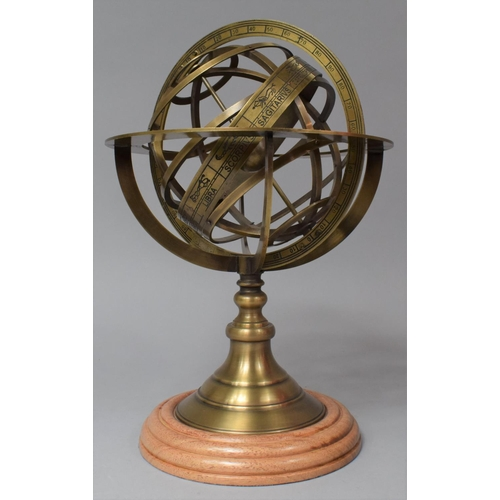 52 - A Reproduction Brass Armillary, Turned Wooden Plinth, 29cm high...