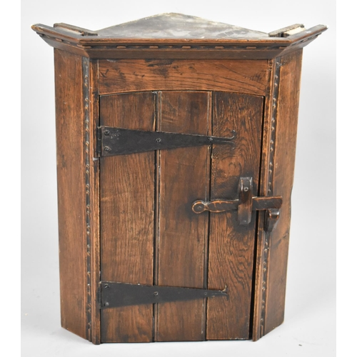 58 - A Small Oak Wall Hanging Corner Cabinet with Iron Hinges and Hinged Door to Shaped Shelved Interior,...