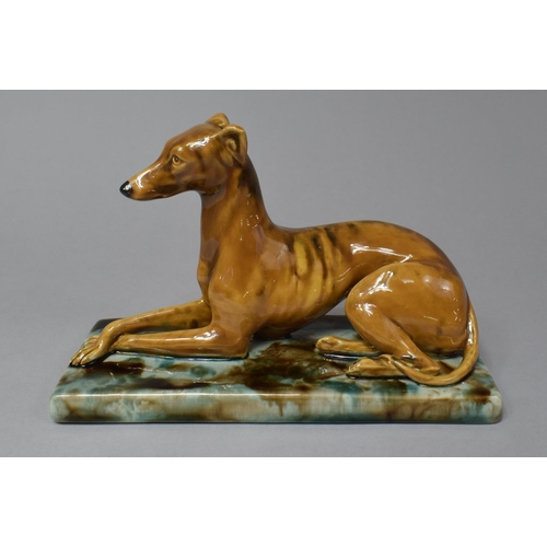 A Mintons Majolica Study of a Reclining Greyhound, 18.5cm High
