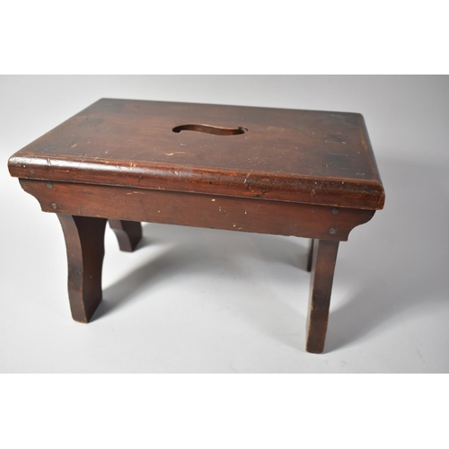 10 - A Late 19th/Early 20th Century Mahogany Rectangular Stool with Cut Out