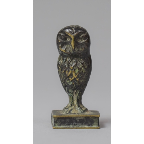 19 - A Small Bronze Seal in the Form of an Owl Standing on Book, 4.25cm high