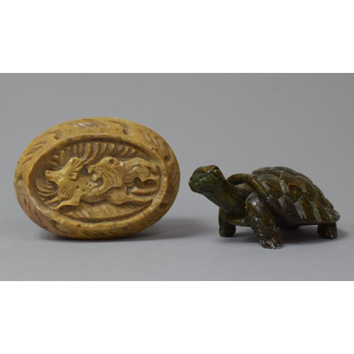 20 - A Carved Oval Soapstone Paperweight Depicting Lion Attacking Antelope Together with a Green Patinate...