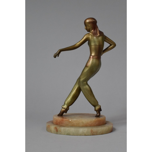 26 - An Art Deco Patinated Bronzed Effect Bronze Effect Metal Figure of a Dancer on Oval Stepped Onyx Pli...