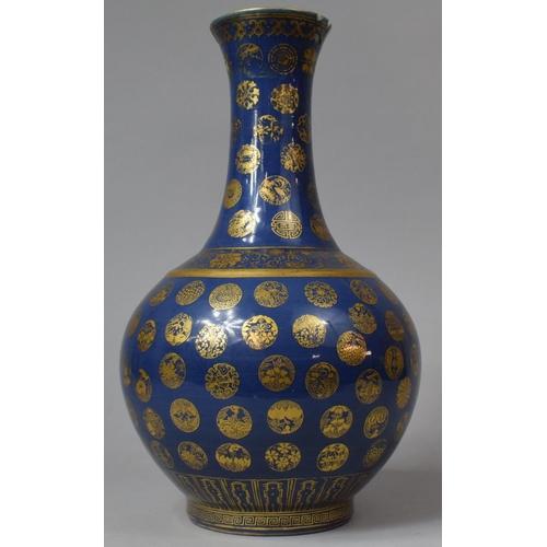 273 - A late Qing Dynasty (1644-1912) Chinese Powder Blue Bottle Vase Decorated with Gilt Shou Symbols, fl...