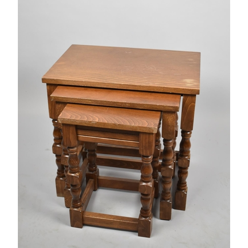45 - A Modern Nest of Three Oak Tables, Largest 48cm Wide...