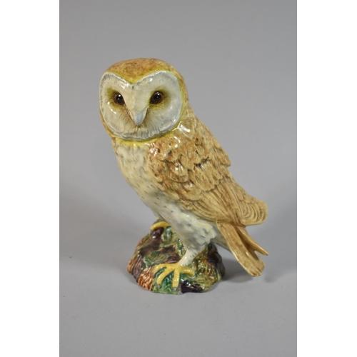 55 - A Beswick Model of a Barn Owl, no.1046, 19.5cm high...