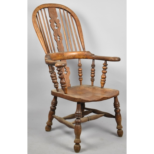 666 - A 19th Century Elm Seated Broad Arm Windsor Chair with Pierced Splat, Outswept Arms, Solid Feet...