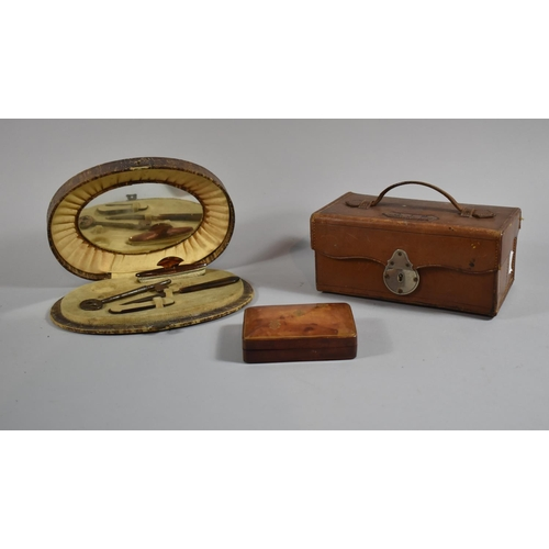 8 - An Early 20th Century Oval Crocodile Skin Manicure Set Together with an Italian Leather Stud Box and...