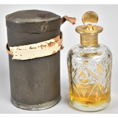 27 - A 19th Century Gilt Decorated Baccarat Scent Bottle, In Original Cylindrical Tin Having Unreadable P...