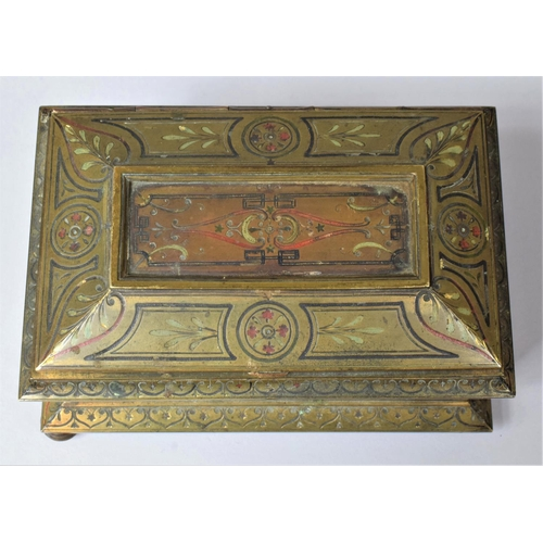 30 - A Heavy French 19th Century Gilt Brass Jewellery Casket of Sarcophagus Form Having Red and Green Ena...