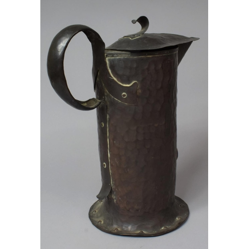 43 - An Arts and Crafts Hammered Copper Lidded Jug, Stamped for William Soutter & Sons with Riveted Side ...