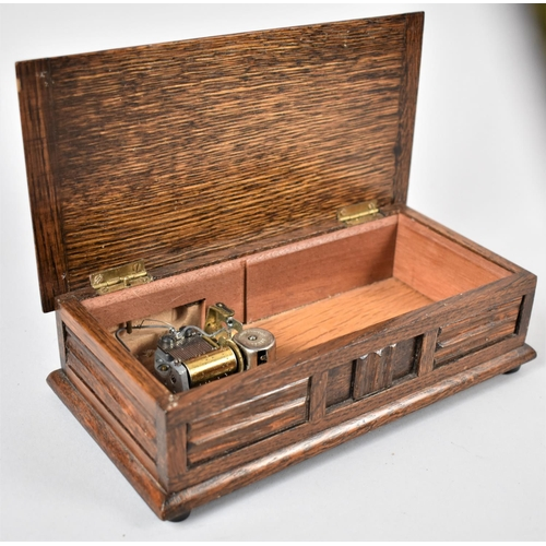 8 - A Mid 20th Century Oak Musical Box by Tallent, Movement Overwound