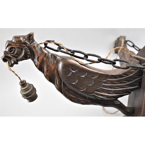 52 - A Mid 20th Century Carved Wooden Ceiling Light Fitting, the Supports in the Form of Mythical Birds, ...