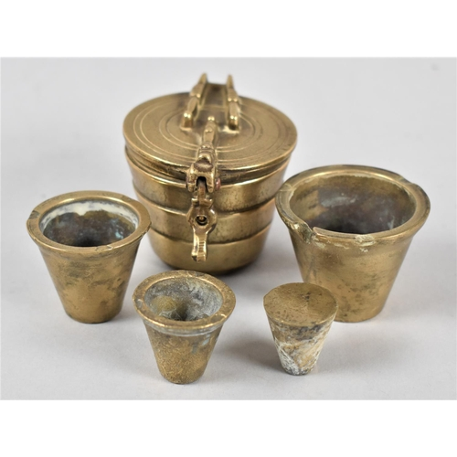 22 - A Set of Four Cylindrical Tapering Graduated Brass Weights in Container with Hinged Lid, 5cms Diamet...