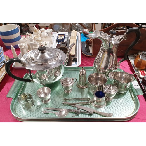 3 - A silver plated tea set and other metal ware.