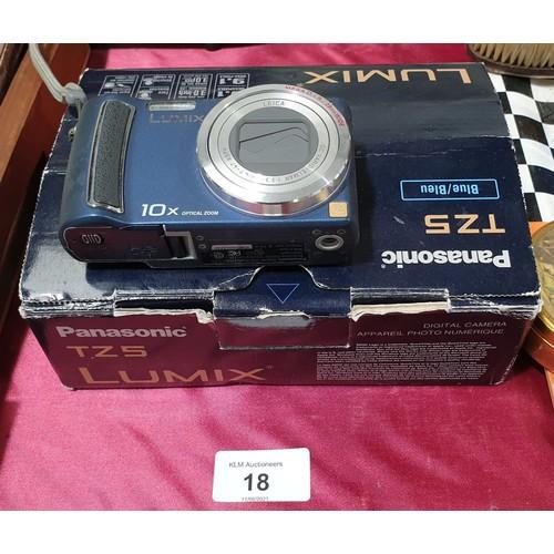18 - A Panasonic TZ5 Lumix camera.