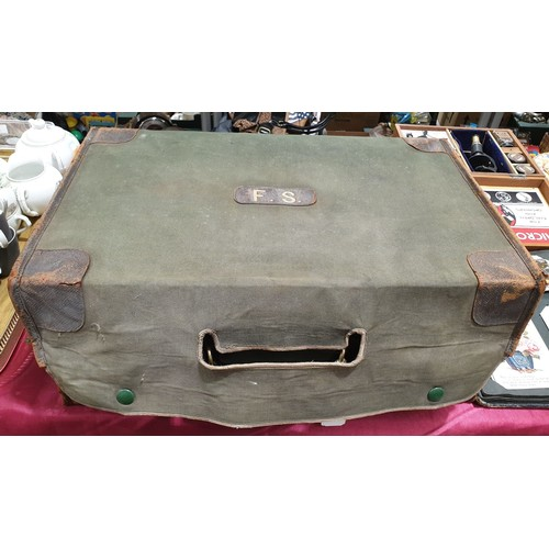 38 - A  vintage leather case with fitted sample trays: width 19.25