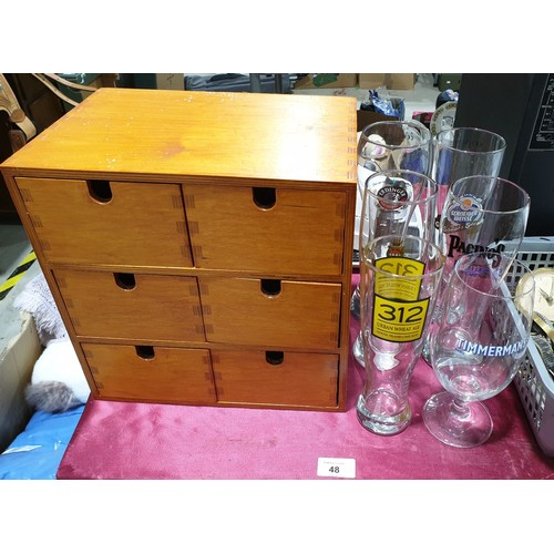 48 - Six branded beer glasses and a wooden storage box.  No in house shipping, please collect or arrange ...
