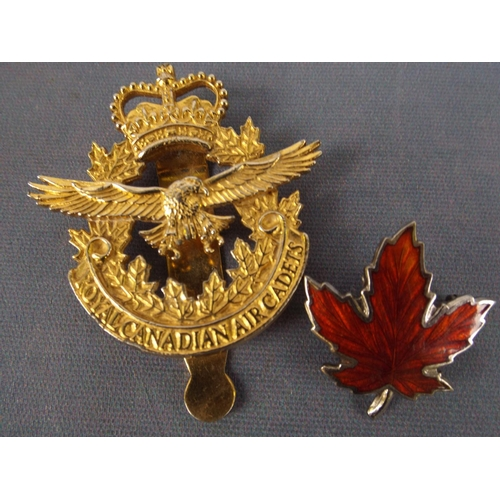 20 - Royal Canadian Air Cadets cap badge along with Sterling silver & Enamel Maple leaf lapel badge...