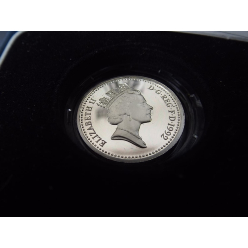 29 - Silver Plated £1 coin in Mint condition in original Royal Mint presentation box...