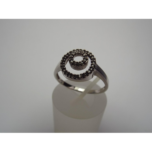 58 - 9ct white Gold Concentric circles Diamond set ring. 3.0g Finger size 'U'...
