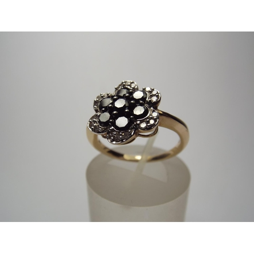 59 - 9ct gold Multi set Diamond ring in Flower pattern, almost 1 carat of Diamonds. 3.3g Finger size 'P'...