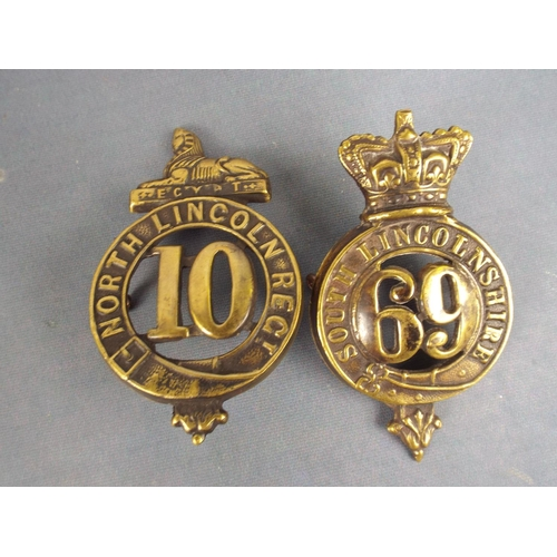 6 - Two  WW1 Lincolnshire regiment badges, poss reproduction...